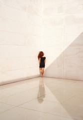 Young woman standing in corner. Concept