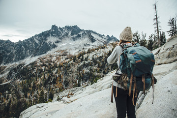 Backpacker looks out to Mountainous scenery