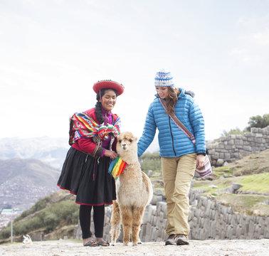 Female Tourist with Traditional Peruvian Woman in Peru