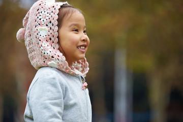 lovely little asian little girl playing outdoor