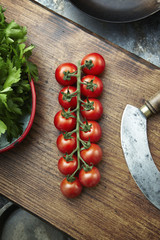 Cherry tomatoes on a wooden chopping board