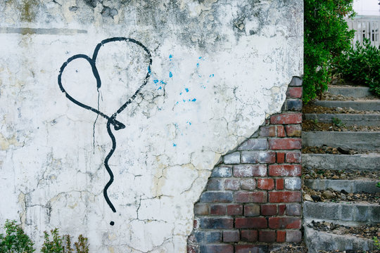 Spray painted heart on a wall