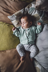 Baby Sleeping on the Pillows