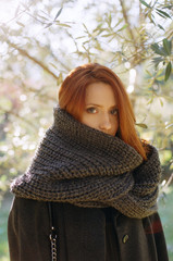 Young woman wrapped in grey scarf