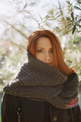 Portrait of a woman wrapped in a scarf