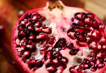 Pomegranate Cut Open on Cutting Board in Closeup