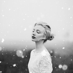 Portrait of a beautiful young woman and a snow
