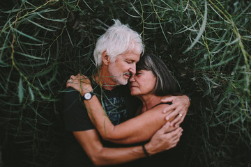Old couple embracing in the branches