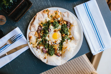 Margarita pizza with arugula and egg for breakfast