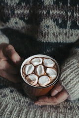 Woman holding hot cocoa
