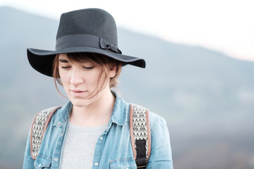 Young Woman with Hat Exploring the Nature