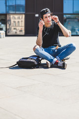 Teen Skater Listening to Music in the City