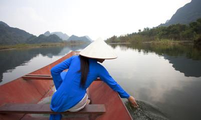Vietnamese women in traditional costume. Vietnam.