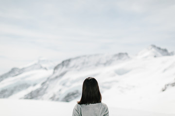 Back profile of a young woman,Swiss Alps, Switzerland
