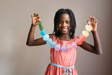 African American girl holding an Easter egg garland