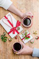 Romantic couple having Christmas morning with coffee, gifts, presents, and candy canes