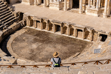 People visit The ruins of Antique Theater in ancient Greek city Hierapolis, Pamukkale, Turkey.