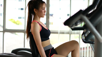 Sport woman exercise with spin bike