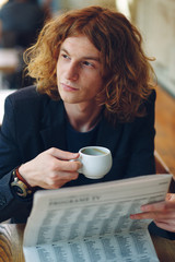 Hipster man drinking coffee while thinking of future