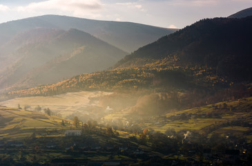 foggy autumn sunrise in mountainous rural area