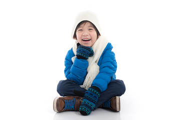 Happy asian child in winter clothes