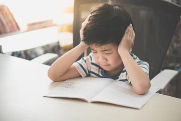 Asian child working on hard homework