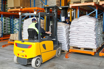 Forklift lifting food sacks