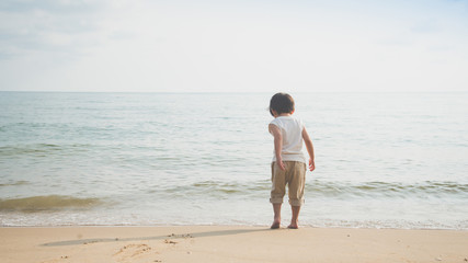 asian boy playing on the beach