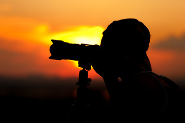 Silhouette of male photographer taking pictures