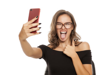 Young beautiful woman take selfies on white background