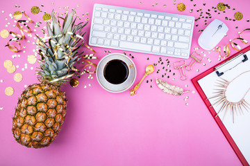 Flat lay fashion feminine home office workspace. Festive female background. Holidays women's desk laptop, coffee cup, golden confetti and jewelry. Top view