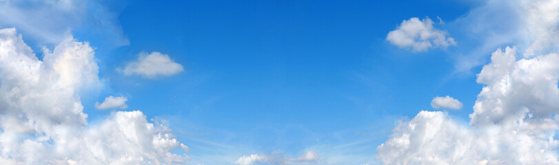 The vast blue sky and clouds sky in landscape view. Blue sky background in perspective panorama view with white clouds and copy space in center.