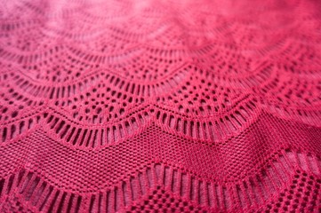 Sophisticated pattern on ruby red lacy fabric