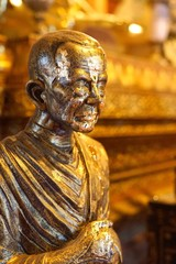 """Statue of famous monk names """"Somdet Toh"""" or """"Somdet Budhacariya (Toh Brahmaransi) covered by gold leaf sheets in main hall of Wat Phumin or Phu Min Temple, The famous ancient temple in Nan, Thailand"""