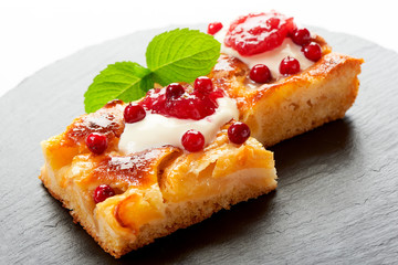 Apple cake with cream, jam and forest berries