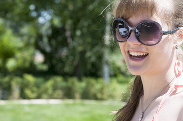 Portrait of a smiling girl in sunglasses