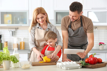 Family cooking in kitchen. Cooking classes concept