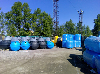 Stacks of septic tanks and other storage tanks at the manufacturer shipment depot