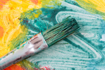 Dirty watercolor brush on colorful painting