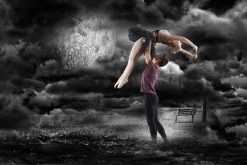 Composite image of man holding ballerina