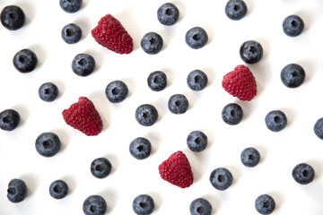 Blueberries and Raspberries Scattered Isolated on White Background Abstract Pattern Top View