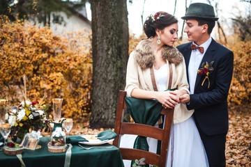 couple in love celebrating wedding in autumn