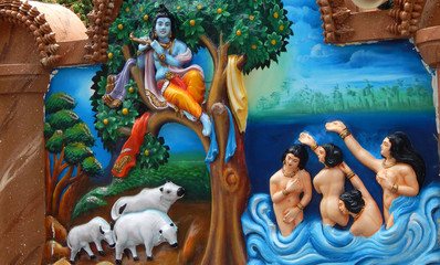 wall art of God Krishna steal clothes of Gopis bathing in Yamuna river naked to teach them a lesson in aTemple