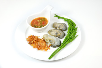 Oyster and seafood sauce on white dish.