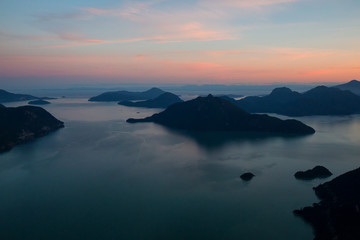 Aerial view of Howe Sound during a vibrant summer sunset. Taken North of Vancouver, British Columbia, Canada.