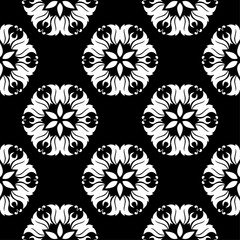 White floral design on black background. Seamless pattern