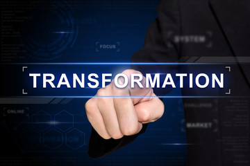 business hand pushing transformation button on virtual screen
