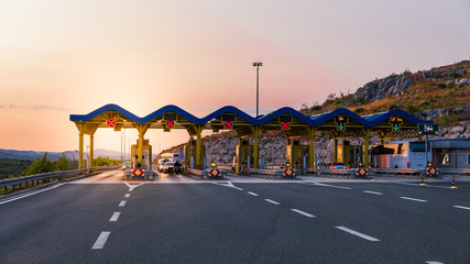 Cars passing through the toll gate on the motorway, vivid trabel