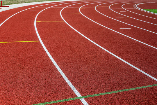 Red treadmill in sport field.