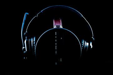 Headphone on the portable music box, blue light.